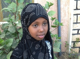"""Hikma Jamal Ali, 12 Somali, Ethiopia. To learn my education, to protect my right and safety. Article 26 """"Government must provide extra money for the children of family in need"""" I have a neighbour friends of poor family, their father has passed away and their mother has nothing, they cannot go to school that I am going to and they are not happy. On our holy day (EID Al-Fatir), they were crying for the mother to buy clothes for them but she can't afford it, and my mother gives her money to buy clothes to them. They are a children like me, so if the Government continue supporting this children of poor family, they can learn and change their life, their family life and will be asset to our country. My views are not ignored but sometimes in schools my teacher do ignore my view. What My teacher always come with his note book and let us read only once and he will take it back. But I wish I could have that note. When I ask, he will not let me explain why I need it but just say NO. My future looks bright and educated lady, I wish I can be a doctor helping female of Ethiopia those who don't want to show their body to men's and I also wish to help poor children in future. I wish there will be opportunity for me and children in my area to have a historical place visit in different part of our country."""