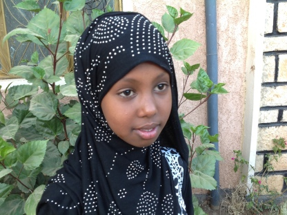 "Hikma Jamal Ali, 12 Somali, Ethiopia. To learn my education, to protect my right and safety. Article 26 ""Government must provide extra money for the children of family in need"" I have a neighbour friends of poor family, their father has passed away and their mother has nothing, they cannot go to school that I am going to and they are not happy. On our holy day (EID Al-Fatir), they were crying for the mother to buy clothes for them but she can't afford it, and my mother gives her money to buy clothes to them. They are a children like me, so if the Government continue supporting this children of poor family, they can learn and change their life, their family life and will be asset to our country. My views are not ignored but sometimes in schools my teacher do ignore my view. What My teacher always come with his note book and let us read only once and he will take it back. But I wish I could have that note. When I ask, he will not let me explain why I need it but just say NO. My future looks bright and educated lady, I wish I can be a doctor helping female of Ethiopia those who don't want to show their body to men's and I also wish to help poor children in future. I wish there will be opportunity for me and children in my area to have a historical place visit in different part of our country."