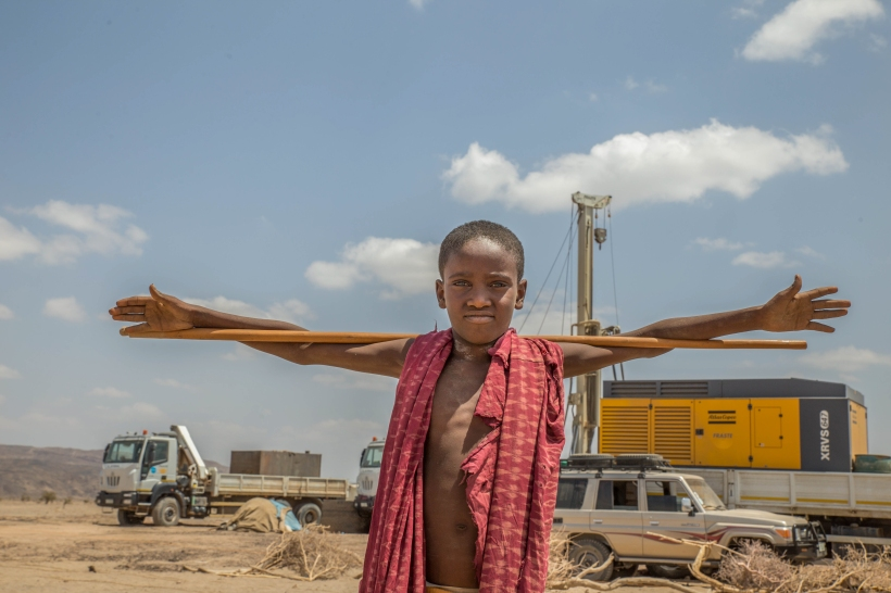 Udo Mohammed 6, poses for picture under the blistering heat fort the first time in his life. Apparently he's excited that the borehole drill was successful in extracting water from the ground in Musle Kebele of Kore Woreda March-9-2016. © UNICEF Ethiopia/2016/Ayene