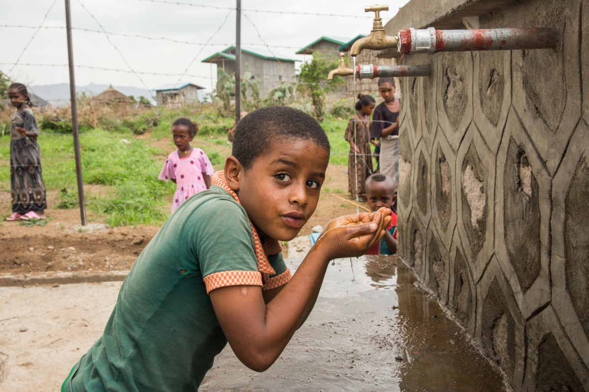 Boys and girls in Woiru Dikala kebele can grow healthily as they have unrestrained access to clean water. They can also attend school more regularly without worrying about fetching water.        © UNICEF Ethiopia/2016/Mersha